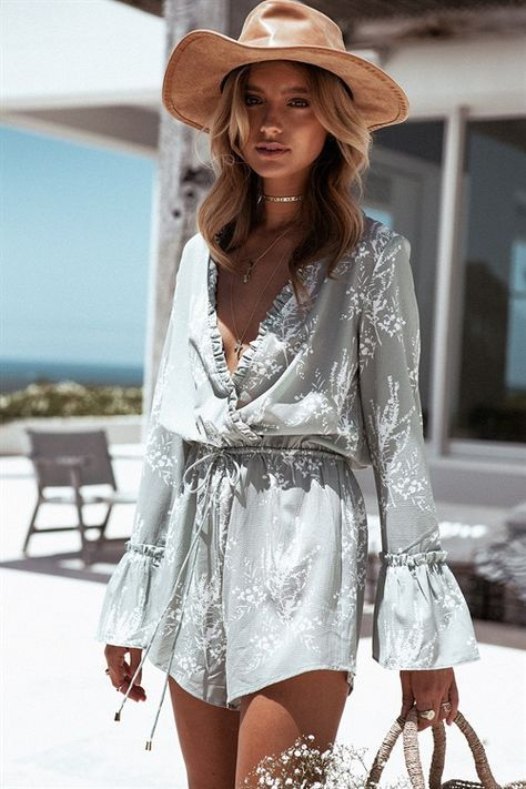 a grey romper with white floral prints, ruffles, bell sleeves for a free spirited look