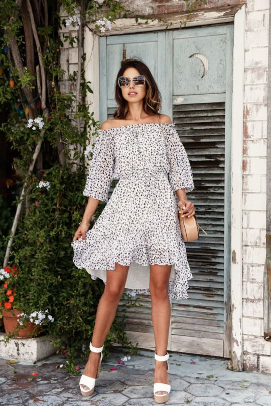 a light off the shoulder polka dot print short dress with a high low skirt, white platform sandals and a tan bag