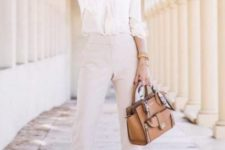 08 a white blouse with long sleeves, cream cropped pants, tan shoes and a tan bag