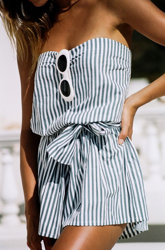 a strapless striped romper with a sash for a coastal inspired feel