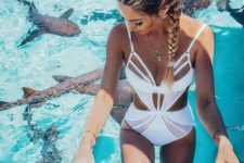09 a white cutout and strappy one piece swimsuit with spaghetti straps for a bold look