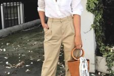 09 a white shirt, beige cropped pants, comfy edges and a trendy barrel bag