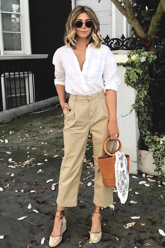 a white shirt, beige cropped pants, comfy edges and a trendy barrel bag