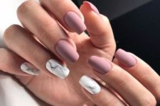 09 matte mauve nails with white marble accents is a trendy and edgy idea
