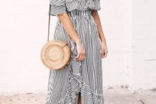 10 a black and white ruffled striped off the shoulder dress with an asymmetric skirt, a round bag and tan slippers