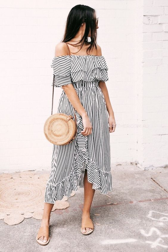 a black and white ruffled striped off the shoulder dress with an asymmetric skirt, a round bag and tan slippers