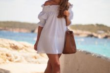 10 a white off the shoulder ruffled mini dress with half sleeves is a very comfy piece to wear