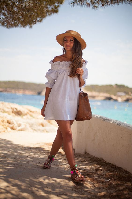 a white off the shoulder ruffled mini dress with half sleeves is a very comfy piece to wear