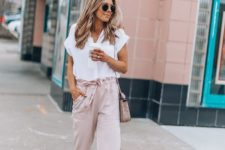 10 blush pants with a bow sash and a white tee, white flats and a pink bag