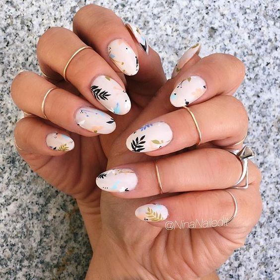 chic pastel nails with floral and botanical prints for a tender girl