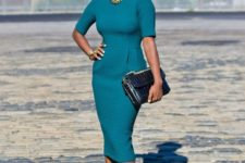 11 a bold teal fitting midi dress with short sleeves, printed shoes and a clutch