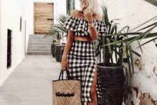 a buffalo check outfit with an off the shoulder crop top and a midi skirt with a side slit