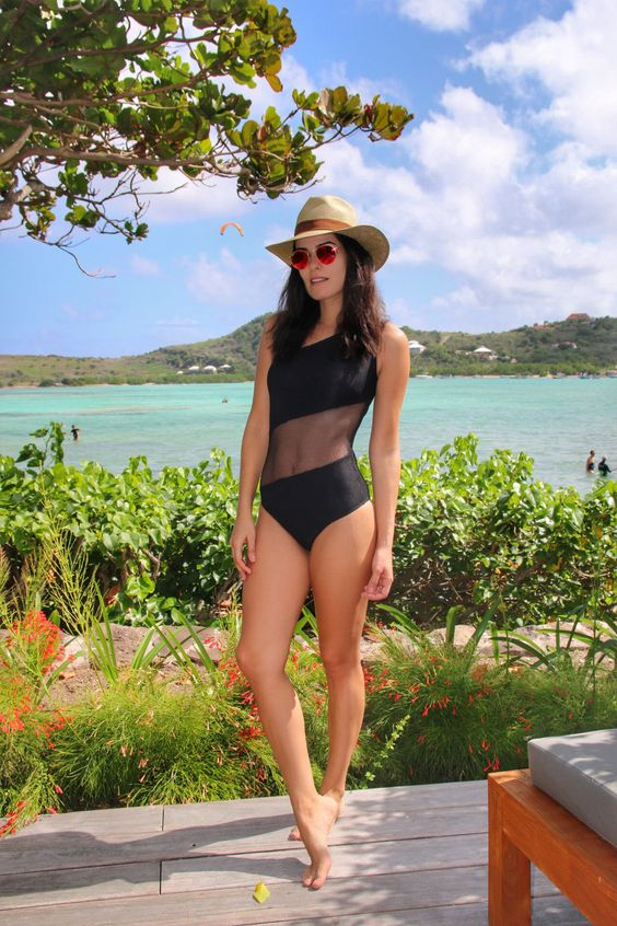 a chic one peice swimsuit with a sheer insert makes a wow effect