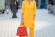 12 a bright yellow pantsuit with a long pocket top and a hot red bag for an office look