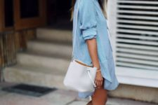 12 a chambray mini dress, a white bag, tan strappy heels and a hat comprise a cool relaxed look