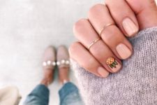 12 a nude manicure with a half pineapple for a cute and fun touch