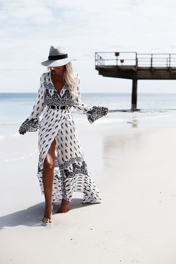 a printed wrap maxi dress with long sleeves and a hat to create a cool boho look