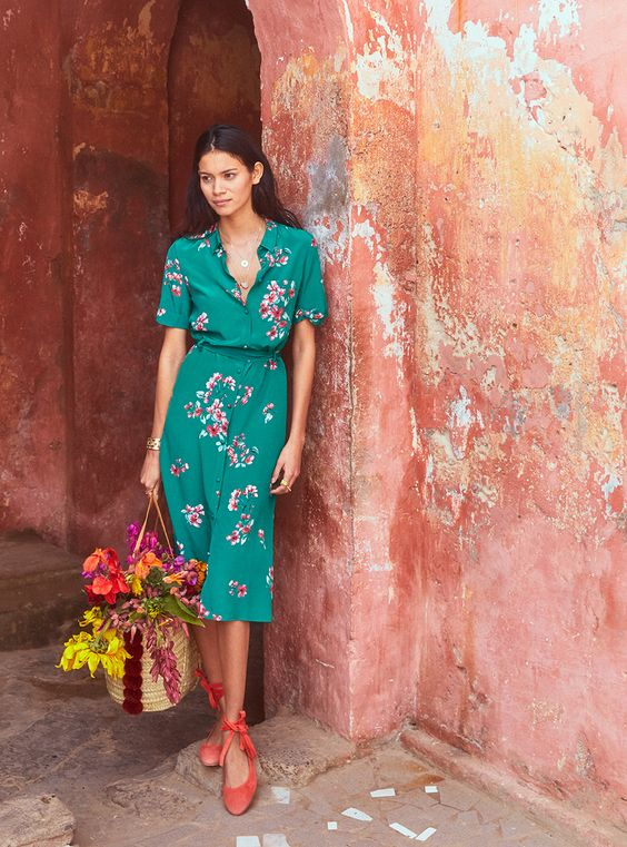 a teal midi shirtdress with short sleeves and a pink floral print and red bow flats