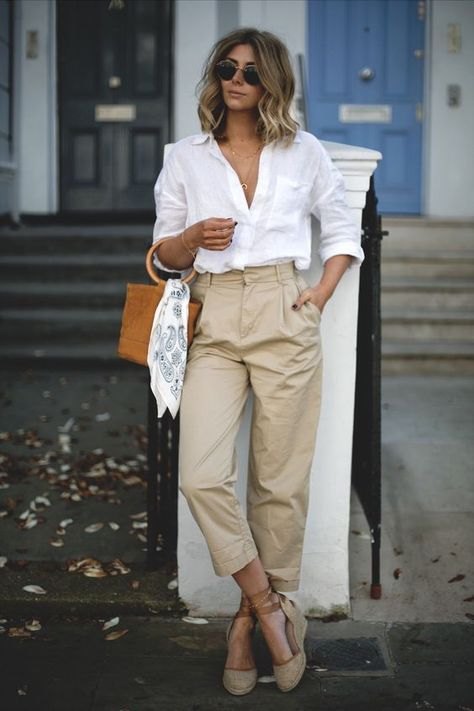 a white shirt, tan wide leg pants, a trendy barrel bag and espadrilles