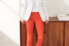 12 a white top, orange cropped pants, black flats and a white windowpane blazer for a bold look