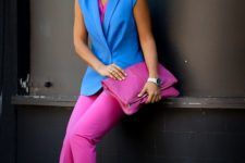 13 a color block look with a hot pink top, pants and a clutch and bold blue shoes and a vest