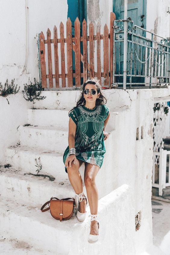 a green mini dress with embroidery, a tan bag and espadrilles