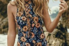 13 a navy floral one piece swismuit with a criss cross laced up plunging neckline