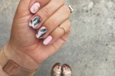 13 a pink manicure with tropical leaf prints and geometric touches