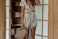 13 a striped boho romper with a deep V-neckline and lace up shoes
