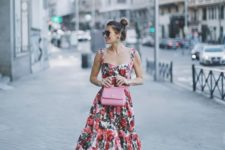 13 a thick strap bright floral maxi dress with a ruffled skirt, a pink bag and black shoes