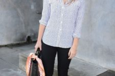 13 black cropped pants, a blue printed shirt, nude flat shoes and a black bag