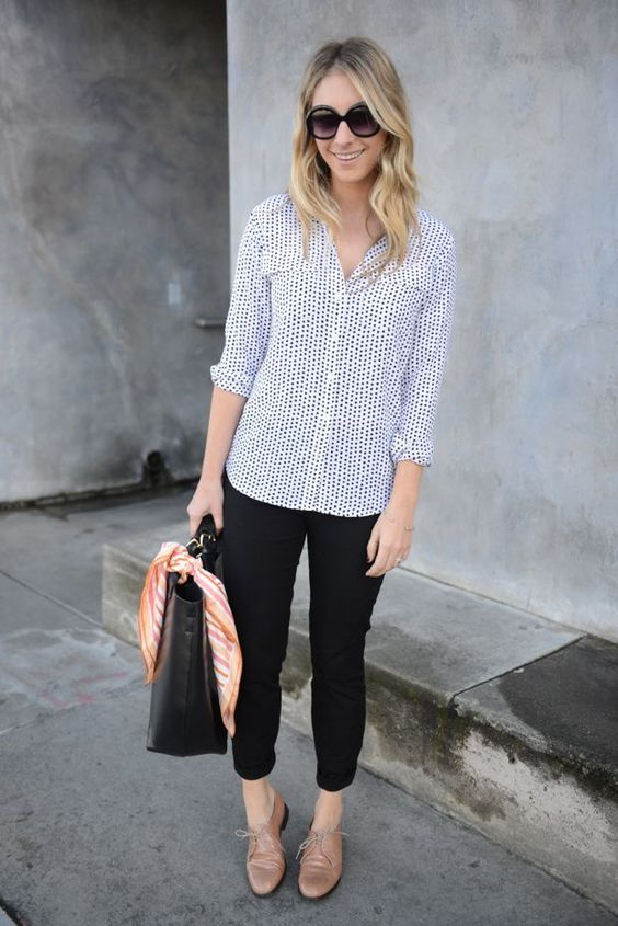 black cropped pants, a blue printed shirt, nude flat shoes and a black bag