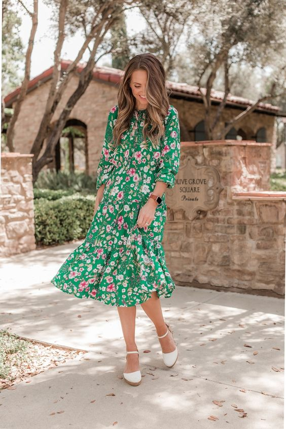 a vintage-styled green midi dress with a pink floral pint and espadrilles