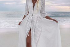 14 a white boho lace maxi dress with long sleeves is a trendy piece
