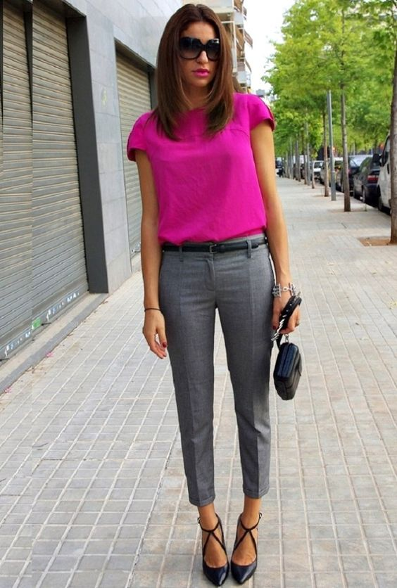 grey cropped pants, a pink top, black strappy heels for a bold work look