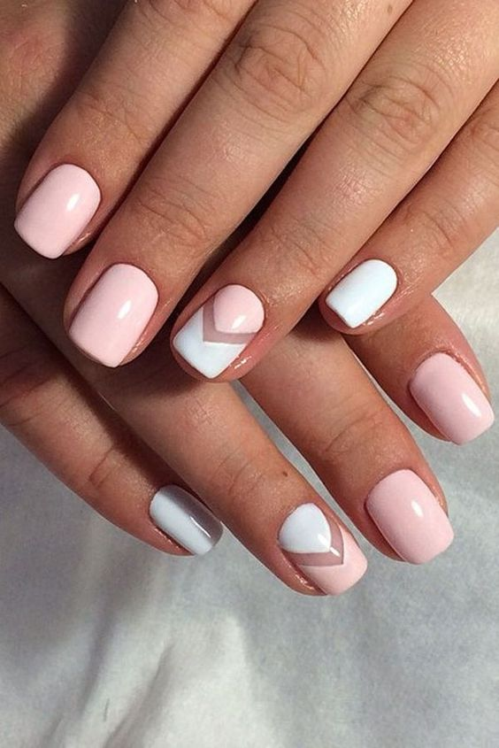 light pink and white manicure with negative space chevrons for a laconic look