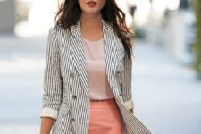 15 a pink skirt, a blush top, a striped black and white jacket