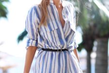 15 a striped blue and white shirt-style tunic with a thin belt to accent the waist