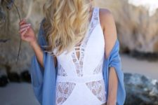 15 a white lace swimsuit with a plinging neckline made more modest with two straps