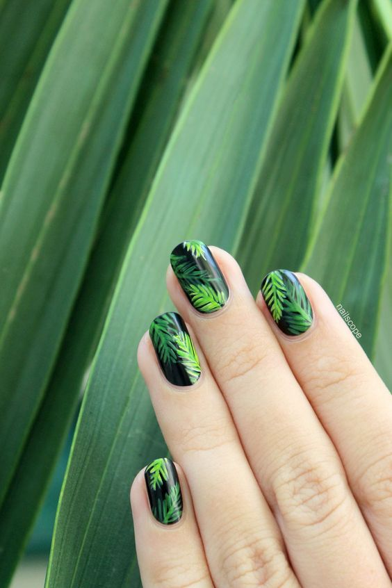 palm tree nails in black and green for a bold statement
