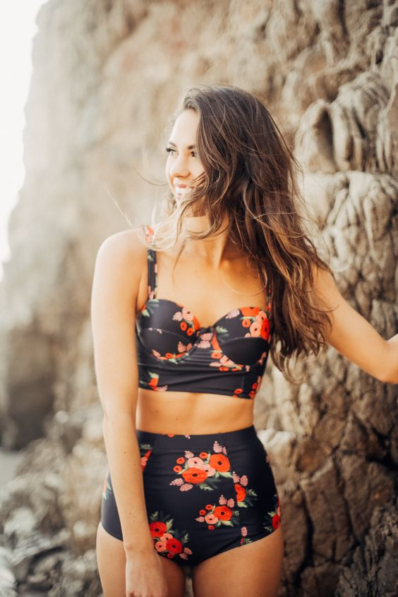 a vintage inspired black floral two piece swimsuit with a high waisted top