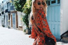16 an orange printed romper with a cutout back is a bold statement