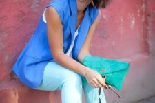 16 mint cropped pants, a white top, a bold blue vest, turquoise shoes and a clutch