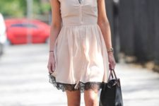 With beige flats and black bag