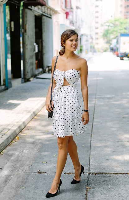 With black bag and black pumps