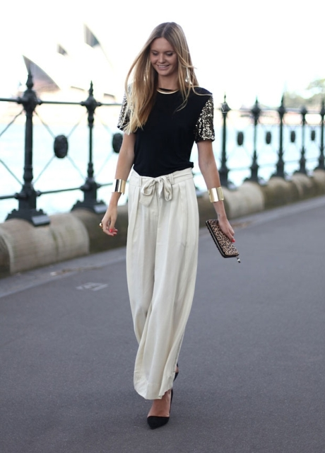 With black blouse, black pumps and printed clutch