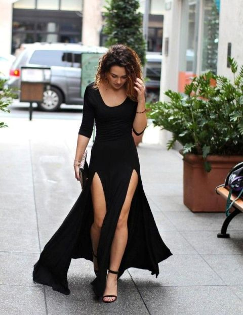 With black high heels and clutch