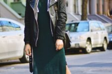 With black jacket, black bag and sneakers