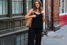 With black jumpsuit and black sandals