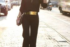 stylish all black look with a metallic belt